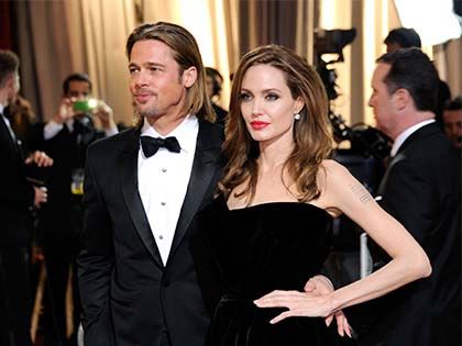 45 Photos Of Brad Pitt And Angelina Jolie Looking In Love Through The Years